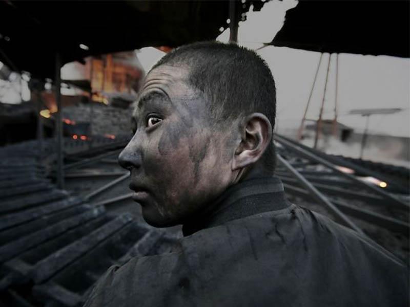 Lu Guang Fotoperiodista desaparecido por capturar amenazas ambientales