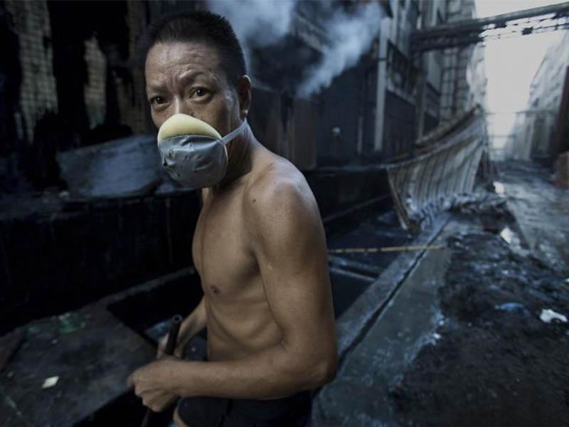 Lu Guang Fotoperiodista